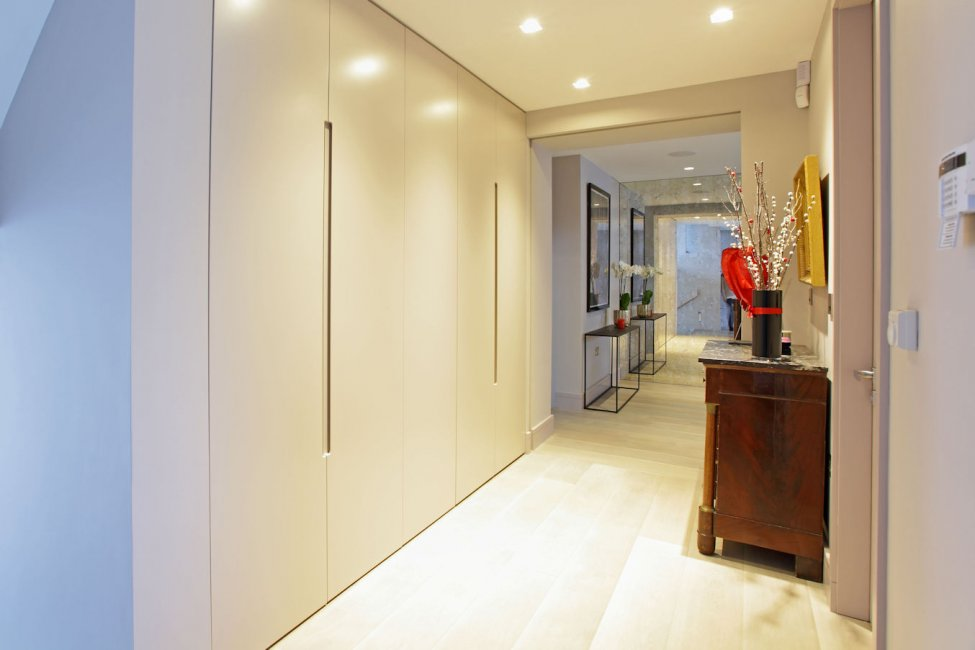 Hallway cupboards in a spray-painted finish