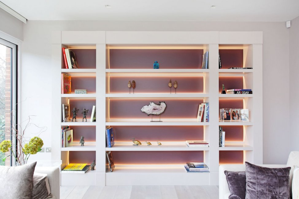 Living room display shelving with lighting at the back of the shelves