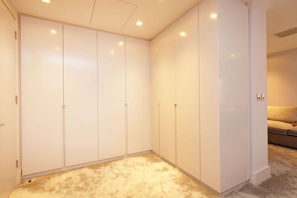 Dressing room featuring concealed doors